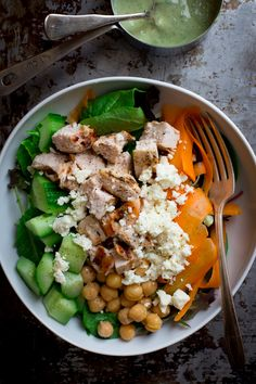 Here is the Chicken and Chickpea Green Goddess Power Salad recipe I talked about yesterday.It has cucumbers, paper thin ribbons of carrot and crumbled feta cheese. The chicken is marinated in a garlic and red wine vinegar marinade. The dressing is home-made Green Goddess made with avocado, tahini and buttermilk.