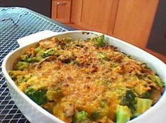 Broccoli CasseroleGREDIENTS    1/2 cup mayonnaise  1/2 cup plain yogurt  1 1/4 cup shredded sharp cheddar cheese  1/3 cup blue cheese dressing  2 eggs  1/2 teaspoon salt  1 1/2 teaspoon fresh ground black pepper  Flavor Pack from Ramen  6 cups broccoli, peeled stems and heads, chopped and blanched in salted water  12 ounces sliced mushrooms, Sauteed in 1 tablespoon butter  1 package chicken flavored Ramen noodles, broken up  RECIPE TOOLS          DIRECTIONS    Preheat oven
