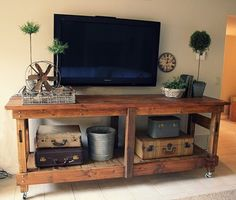Love this industrial workbench that they stained and used for TV stand. You could totally do this for a console table, coffee table, etc.