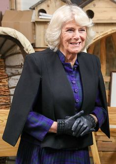 Camilla Parker-Bowles looked stylish at the the Frome Medical Centre wearing a black cape and a tartan top and skirt. The wife of Prince Charles added black boots and gloves Camilla Duchess Of Cornwall, Duchess Of Cambridge, Home Wrecker, Camilla Parker Bowles, Princess Anne, Prince Of Wales, Queen Elizabeth Ii, British Royals, Kate Middleton