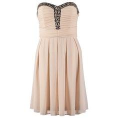 Binnenkort een cocktailparty? Hier is je jurkje dan, elegant en vrouwelijk!