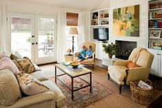 These homeowners flanked the hearth with an additional bookshelf designed to accommodate the television.  See this Great Room