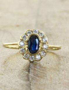 Antique vintage engagement ring, yellow gold with dark blue sapphire