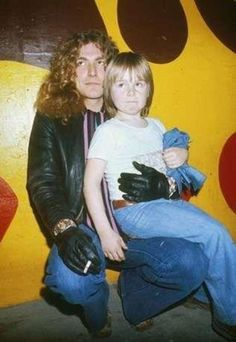 Robert Plant (holding Jason Bonham the day after his father John Bonham passed away)