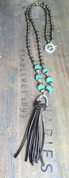 Beaded necklace with natural wood beads, African sea glass, toggle clasp and leather tassel