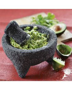 A mortar and pestle is a kitchen essential. This one was carved from volcanic rock. Get it here: http://www.bhg.com/shop/williams-sonoma-molcajete-p505864a182a7db34a806007b.html