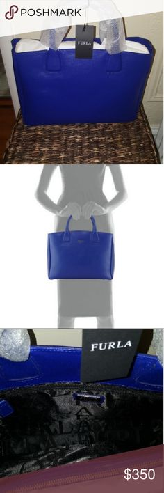 """Furla Camilla Medium Leather Tote Bag, Blue Laguna Furla saffiano leather tote bag with golden hardware. Rolled top handles, 4"""" drop.Removable shoulder strap, 20"""" drop. Open top. Metal logo lettering at top center. Interior, center zip compartment; one zip and two slip pockets. Metal feet protect bottom of bag. 9.8""""H x 13.3""""W x 4.3""""D; weighs 1 lb. 12.1 oz. """"Camilla"""" is made in Italy. Furla Bags Totes"""
