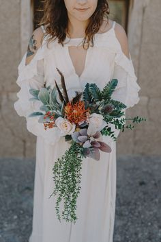 We can hardly believe this gorgeous bridal bouquet was made from artificial flowers   Image by Sam Hugh Photography