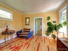 Reclaimed wood floors in this condo alternative in the Woodstock neighborhood of Portland, Oregon