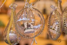 Glass Christmas globes with golden bows and Jesus birth scene