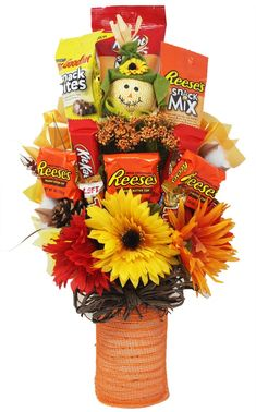 """Chocolate, peanuts, and caramel, oh my!This festive, fall-inspired candy bouquet is the perfect gift for the sugar lover in your life. Whether it be a special occasion, just because, or you plan on keeping it for yourself, this sweet little arrangement will cure any sweet tooth. Fall-inspired candy bouquet with an assortment of Fun Size Candy and Chocolate Bars and Snack Packs. Stands approximately 16.5"""" TallMade to Order to ensure quality and freshness, and shrink-wrapped with a bow to protect Fall Gift Baskets, Candy Gift Baskets, Fall Crafts, Halloween Crafts, Christmas Crafts, Candy Bar Bouquet, Gift Card Bouquet, Candy Arrangements, Halloween Baskets"""