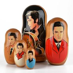 "Elvis Presley 5pc Nesting Doll - This rock-n-roll nesting doll features Elvis Presley five ways. The largest doll measures about 6 1/4"" tall by 3 1/2"" wide, and it features gold cursive lettering spelling Elvis. The backs of all the dolls are left unpainted, which allows the natural beauty of the wood to be seen. This nested doll would be the perfect addition to an Elvis Presley fan's home!"