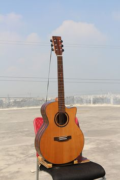 """$112 Model:W-MCS-41A Name:41"""" Solid Top cutaway Acoustic Guitar  Top:A+ Solid Cedar Back & Side:Ebony Binding:ABS+Maple Back Seam:Wood Rosette:Wood Finish:High-gloss Color:Nature  Neck Material: Nato Fingerboard:Rosewood with Inlay Abalone Shell Dot Fret:20 Nut:Bone Nut Width:1 3/4"""" (43mm)                                 Bridge:Rosewood Head machine:High Quality Black Die-cast Saddle:Bone Strings:D'Addario EXP 16 Electronics:As you requested Avaliable Service:Wholesale/ODM/OEM"""