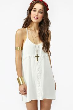 loose white cotton dress, gold arm cuff, gold necklace