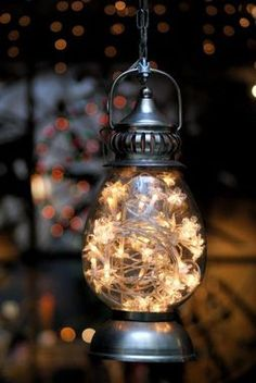 Strand of battery powered lights in a lantern adds a whimsical touch