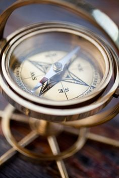 other vintage decor: antique compass. Fun for guest sign-in table