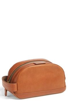 rag & bone Rugged Leather Toiletry Case (Nordstrom Exclusive). Well-grained Italian cow leather with a rugged brass top zip closure and water-resistant nylon lining structures this durable toiletry case equipped for all the grooming essentials you need when travelling.