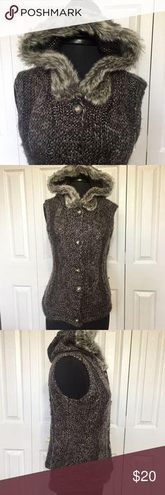 Natural Reflections hooded sleeveless cardigan. This sweater is button front with faux fir rimmed hood. Has cable knit details. Yarn in not pilled, but has a soft furry texture. It is in good condition without any rips or stains. Measurements taken flat and in inches. Shoulder to shoulder 17. Armpit to armpit 181/2. Back center to hem 22. Natural Reflections Sweaters Cardigans