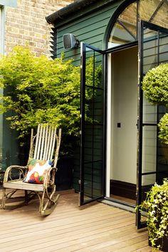 Green & Black. Double Doors - City Gardens - Small Space Garden Design (houseandgarden.co.uk)