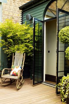 Double Doors onto deck with bentwood rocker - City Gardens - Small Space Garden Design (houseandgarden.co.uk)