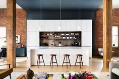 A bright white kitchen stands out in this open-concept apartment.