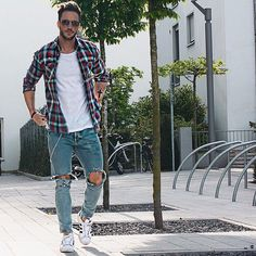 Ripped jeans with a white shirt and flannel is an easy look to recreate for some cool street style.