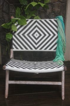 Black and white rattan and teak lay back chair by TuttiAbode