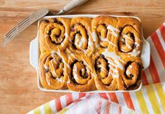 Make-Ahead Tip: After the assembled unbaked cinnamon rolls have risen, cover them in plastic wrap in the pan and refrigerate overnight. Remove plastic wrap and bake the next day, according to recipe directions. (Photo: Chlow Coscarelli)
