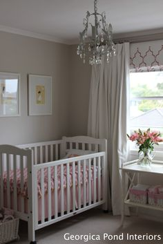 This warm wall colour is perfect with pink in this elegant little girls room