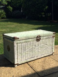 Tired wicker trunk transformed and updated with shabby chic pale green paint over. Glad this didn't sell in the car boot sale now! Only took a couple hours to firstly spray paint an undercoat. Then used lime paint in pale green to shabby chic effect