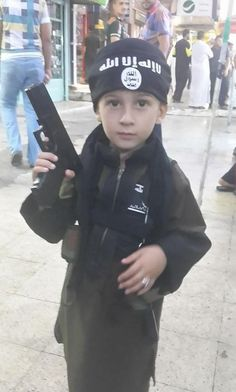 LIVING UNDER ISIS -- WALKING ISIS CONTROLLED STREETS AND SEEING A CHILD WITH A FIREARM COMMON