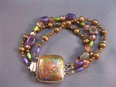Purple, green, and bronze three strand bracelet NEW REDUCED PRICE