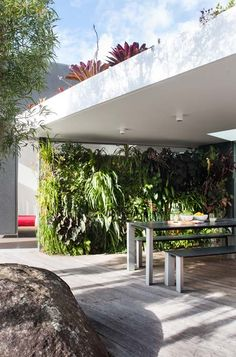 Gorgeous greenwall beneath the patio | At home with Mark and Sarah | Home Ideas magazine