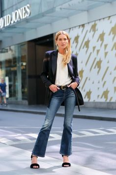 Erin Wasson wears cropped flares, navy blazer and a white t shirt