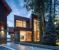 Situated on a narrow strip of land between the forest and the lake, this contemporary residence...