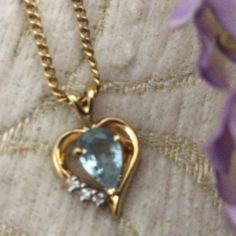 Gold necklace/heart Gold necklace is 18 inches long with a dainty heart blue Topaz with three tiny diamonds. Very  delicate. Jewelry Necklaces