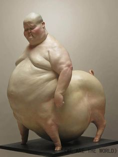 Chinese artist Liu Xue creates sculptures of human figures that have been augmented with animal body parts. The eerily lifelike sculptures range from centaur-like human/pig hybrids to rather disquieting chicken-people.