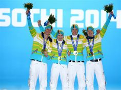 Gold medalists Andreas Wank, Marinus Kraus, Andreas Wellinger and Severin Freund of Germany celebrate during the medal ceremony for the Men's Team Ski Jumping on day 12 of the Sochi 2014 Winter Olympics at Medals Plaza