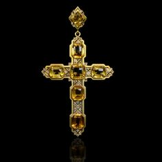 Impressive yellow gold pendant designed as a Roman cross and set at intervals with citrines spaced with rose-cut diamond open-work panels with a small hidden compartment to the reverse and suspended from a similarly designed surmount Mellerio dits Meller, circa 1890