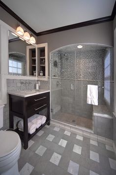 This sweet little bathroom in Bexley has glass, marble, porcelain and ceramic tile in a mix of cool mid tones and warm dark tones.  I really like that there is shine and glitz without making the space gaudy.  #jsbrownco