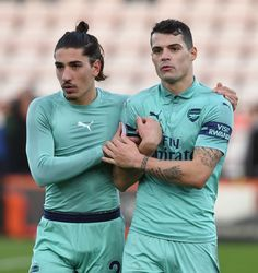 BOURNEMOUTH, ENGLAND - NOVEMBER 25: Hector Bellerin and Granit Xhaka of Arsenal after the Premier League match between AFC Bournemouth and Arsenal FC at Vitality Stadium on November 25, 2018 in Bournemouth, United Kingdom. (Photo by David Price/Arsenal FC via Getty Images)