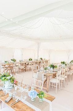 Bright aqua & coral rustic marquee reception with fairy light ceiling and burlap & lace table runners - Lisa Carpenter - Honour By Alan Hannah For A Rustic Marquee Wedding At Axnoller Dorset With Bridesmaids In Mint Green Ted Baker Dresses And Groom In Paul Smith With Images By Lisa Carpenter Photography