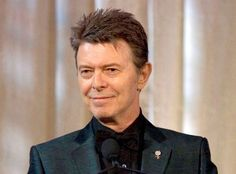 FILE ‐ In this June 5, 2007 file photo, singer David Bowie accepts the lifetime achievement award at the 11th Annual Webby Awards in New York. Bowie's final album, released days after he died of cancer last year, earned him three Grammy Awards on Sunday, Feb. 12, 2017. ﴾AP Photo/Stephen Chernin, File﴿