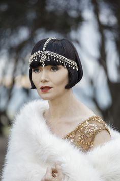 Amazing accessories! Essie Davis stars as Phryne Fisher in Miss Fisher's Murder Mysteries, now streaming on www.acorn.tv.