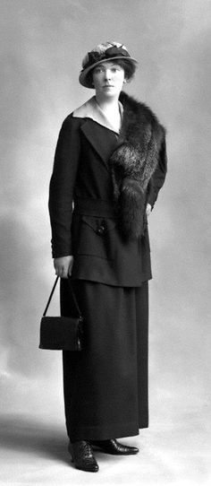 1915 Fashion. [Gone are the flounces and furbelows of the pre-WWI era.  This suit is all comfort and business, although many women still wore corsets, chemises, petticoats and corset covers underneath until ca. 1917.]