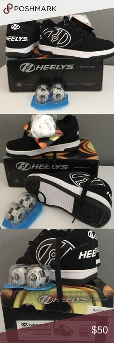 Heelys size youth 3. New in box New with tags and box. Heelys. Shoes with wheels that come off. Kids will have tons of fun with these cool shoes that can be used in or outdoors. Black and white shoes comes with two pair of laces, wheels, and key to put wheels on and take them off. Heelys Shoes Sneakers
