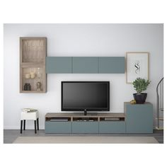 Most latest and graceful TV wall designs. Living room tv Storage Create this coo… Most latest and graceful TV wall designs. Living room tv Storage Create this cool concept in your favorite room. Tv Ikea, Ikea Living Room, Tv Storage, Glass Shelves, Ikea Hacks, Home And Living, Home Furnishings, Interior Design, Glass Doors