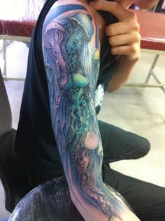 Awesome jellyfish tattoo by Arty Cow Don't really like jellyfish but the colors are beautiful