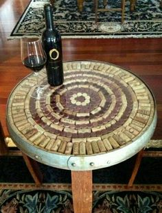 Another great use for your old wine corks and barrels. Glass topped side tables.