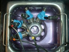 These top feed fuel injectors are being cleaned in an ASNU bench using ultrasonic technology